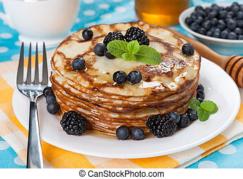 Delicious pancakes with blackberries and mint leaves