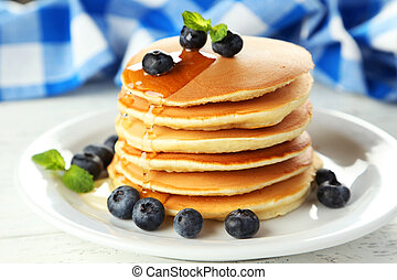 Delicious pancakes with blueberries on white wooden ...