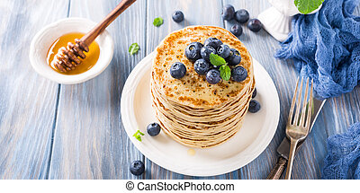 Delicious pancakes with fresh blueberries on a wooden ...