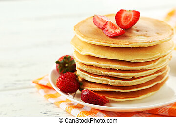 Delicious pancakes with on white wooden background