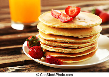 Delicious pancakes with strawberry on brown wooden ...