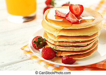 Delicious pancakes with strawberry on white wooden ...