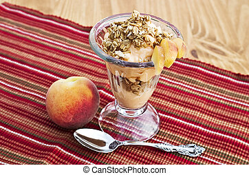 Delicious parfait with peaches, granola and yogurt.