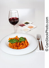 Delicious pasta and red wine served for dinner