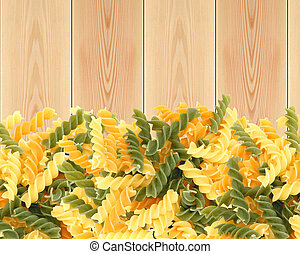 Delicious pasta on wooden table background