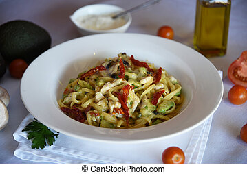 delicious pasta with avocado and to