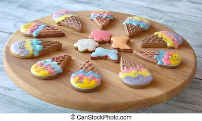 Delicious pastry with colorful glaze. Cookies on wooden board. Baked from healthy ingredients.