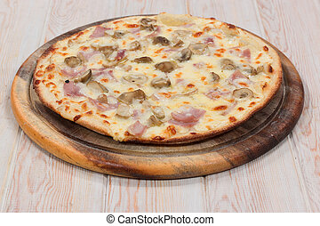 Delicious pizza mushroom with ham on wood