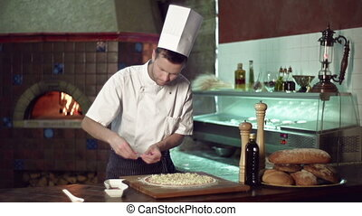 Delicious Pizza - Waist up shot of master chef spreading...