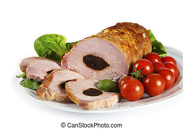 delicious pork loin with plum and baby tomatos on the plate