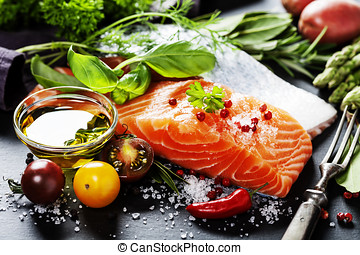 Delicious  portion of  fresh salmon fillet  with aromatic herbs, spices and vegetables