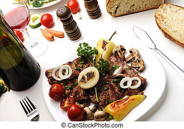 Delicious prepared and decorated food on table at home