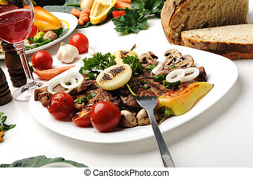 Delicious prepared and decorated food on table in restaurant
