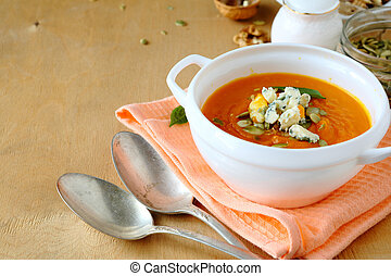 delicious pumpkin soup in a white tureen
