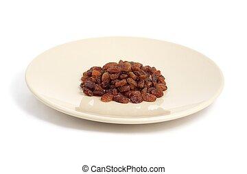 delicious raisins on a plate