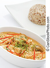 Delicious Red curry with rice on background