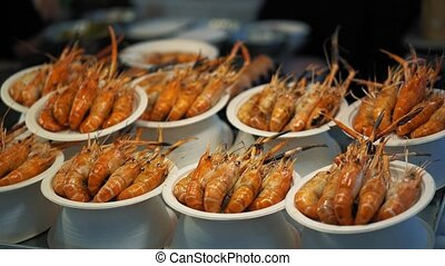 Delicious red prepared shrimp are served on their plates....