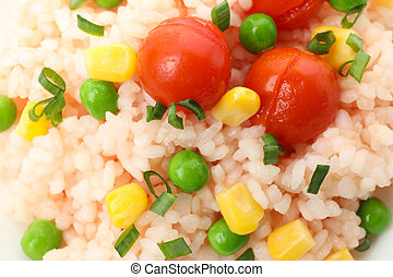 Delicious rice and vegetables texture background, close up