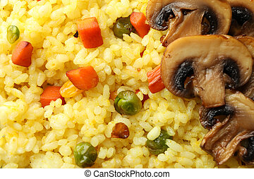 Delicious rice with vegetables and mushrooms background, close up