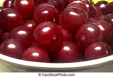 Delicious ripe cherries in a ceramic vase