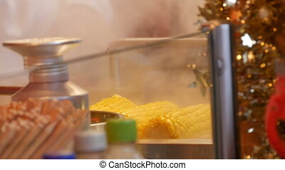 Delicious ripe corn is boiled and steam is emitted on the...