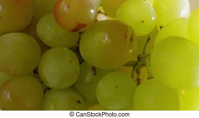 Delicious ripe grapes, close-up, soft focus.