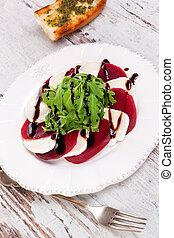 Delicious salad with beet, goat cheese and arugula.