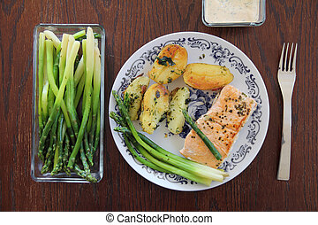 delicious salmon steak with potatoes and asparagus
