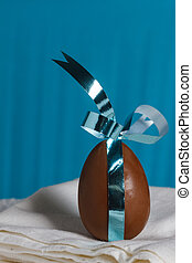 chocolate Easter egg with a ribbon