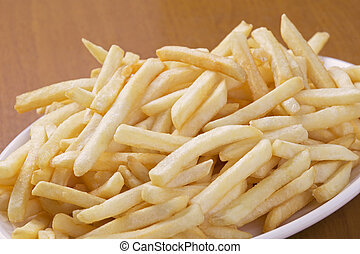 Delicious shoestring style french fries - A plate full of...