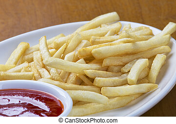 Delicious shoestring style french fries with ketchup - A...