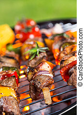 Delicious skewers on grill
