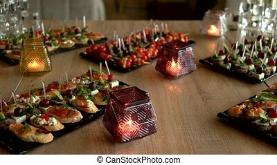 Delicious snacks and appetizers on banquet table. Restaurant...