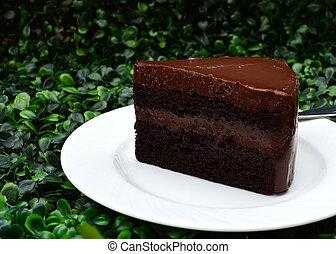 Delicious, soft sliced fresh homemade dark chocolate cake - side view