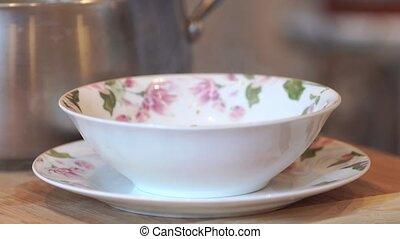 soup poured into a bowl. - delicious soup poured into a...