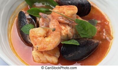 delicious soup with shrimp and seafood to spin in a circle