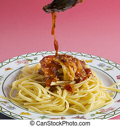 Delicious spaghetti with bolognese sauce served on a white square plate