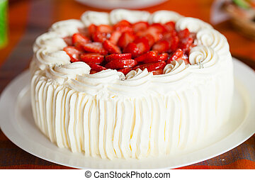 Delicious strawberry cake with strawberries and whipped...