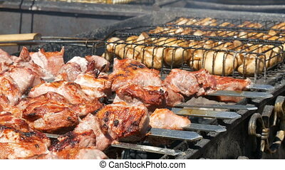 Delicious succulent meat of shish kebab on skewer fry on...