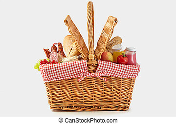 Delicious summer picnic food in a wicker hamper