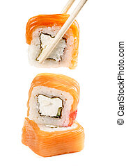 sushi rolls with chopsticks on a white background