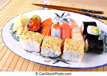 Delicious sushi with red caviar, chopsticks