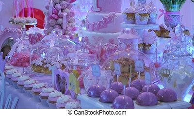 Delicious sweet buffet with cupcakes, Sweet holiday buffet with cupcakes and meringues and other desserts