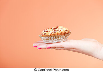 Delicious sweet cupcake in human hand. Gluttony