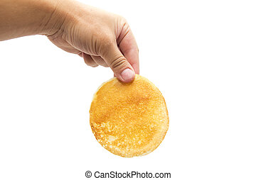 delicious sweet pancake in hand