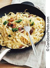 Delicious tagliatelle pasta in a cast iron skillet
