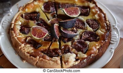 Delicious Tart With Fresh Figs And Goat Cheese On Rustic Wooden Table