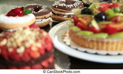 Delicious tart with fresh fruits cakes and donuts