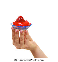 Delicious tasty sweet cake cupcake in human hand.