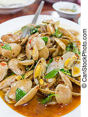 Fried clams with basil